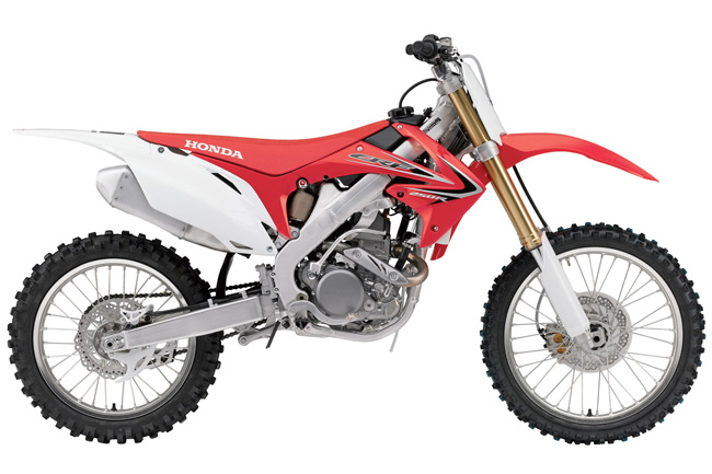 LIke its big brother, the 2011 model CRF250R has also received just minor changes.